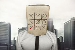 Businessman wearing brown paper bag on head Royalty Free Stock Images