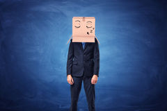 Businessman is wearing cardboard box on head with sleepy face Royalty Free Stock Image