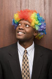 Businessman wearing clowns wig Royalty Free Stock Photo