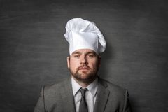 Businessman wearing a cook hat stock photography