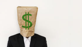 Businessman wearing crumpled brown paper bag, with green dollar sign, business bankruptcy concept, with copy space Stock Image
