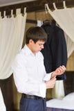 Businessman wearing cufflinks. Elegant young fashion business man Stock Photography