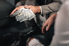 Businessman wearing dark grey jacket giving bribe to the lawyer royalty free stock photos