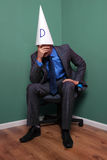 Businessman wearing a dunce hat Stock Photos