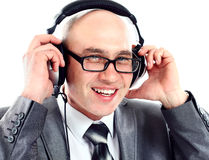 Businessman wearing earphone struggling to hear Royalty Free Stock Image