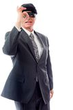 Businessman wearing eye mask and looking through finger's hole. Businessman shot in studio isolated on a white background Royalty Free Stock Photos