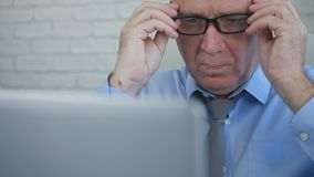 Businessman Wearing Eyeglasses Read Preoccupied from Laptop Financial Information.  royalty free stock image