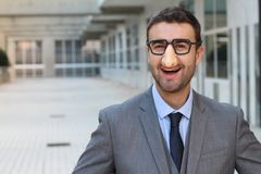 Businessman wearing fake nose-glasses combo stock photography