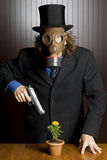 Businessman wearing a gas mask royalty free stock photography