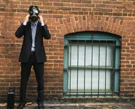 Businessman wearing gas mask. Royalty Free Stock Photos