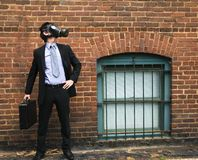 Businessman wearing gas mask. royalty free stock photos