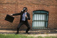 Businessman wearing gas mask. Stock Images