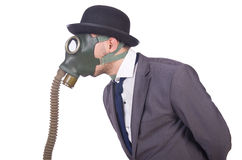 Businessman wearing gas mask Royalty Free Stock Photo