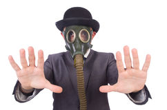 Businessman wearing gas mask. Isolated on white Stock Images