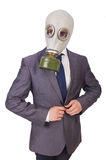 Businessman wearing gas mask. Isolated on white Royalty Free Stock Photography