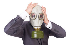 Businessman wearing gas mask. Isolated on white Stock Image