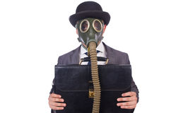 Businessman wearing gas mask Stock Photos