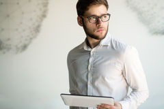 Businessman wearing glasses holding tablet Royalty Free Stock Photo
