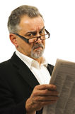 Businessman wearing glasses holds a newspaper. Stock Images