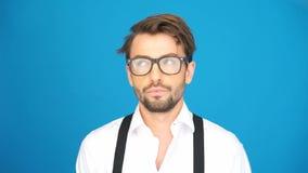 Businessman wearing glasses looking arround