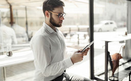 Businessman wearing glasses using tablet Royalty Free Stock Photo
