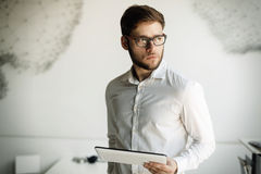 Businessman wearing glasses using tablet Stock Image