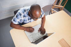 Businessman wearing glasses and working at his desk Royalty Free Stock Photos
