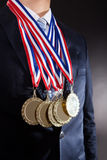 Businessman Wearing Gold Medals Stock Images