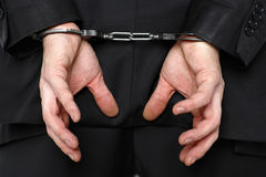 Businessman wearing handcuffs Royalty Free Stock Image