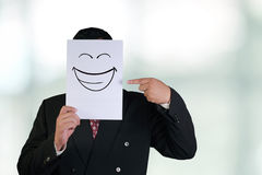Businessman Wearing Happy Laughing Face Mask Royalty Free Stock Image