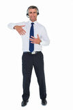 Businessman wearing headphone and doing gesture Stock Photo