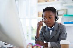 Businessman wearing headphone while working Stock Image