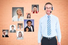 Businessman wearing headphones with colleagues showing various expressions royalty free stock photography
