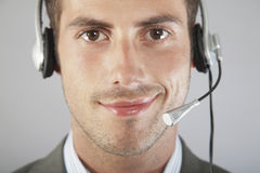 Businessman Wearing Headset Against Gray Background Stock Photos