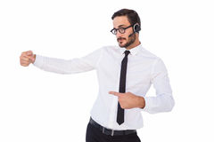 Businessman wearing a headset while showing something Royalty Free Stock Photography