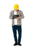 Businessman wearing helmet Stock Photography