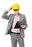 Businessman wearing helmet Stock Photos