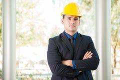 Businessman wearing a helmet Royalty Free Stock Photos