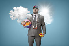 Businessman wearing holiday gear with cloud Stock Images