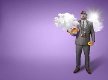 Businessman wearing holiday gear with cloud Royalty Free Stock Image