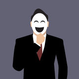 Businessman wearing a laughing mask Royalty Free Stock Photos