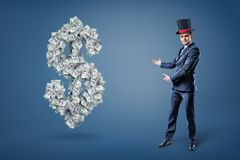 A businessman wearing a magician`s hat and presents a large dollar sign made of many bills. royalty free illustration