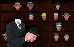 Businessman Wearing Many Hats, Sales. Abstract concept of a businessman wearing many hats. A jack of all trades. Image can be used for business, sales, success Stock Photography
