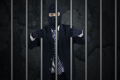 Businessman wearing a mask in jail Stock Images