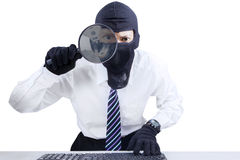 Businessman wearing mask looking for information 2 Stock Image