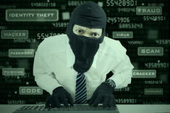 Businessman wearing mask stealing data Stock Photos