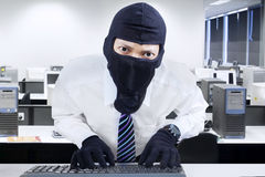 Businessman wearing mask stealing information Stock Image