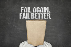 Businessman Wearing Paperbag Under Fail Again Fail Better Text Royalty Free Stock Images