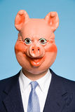 Businessman wearing a pig mask Royalty Free Stock Image