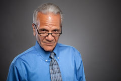 Businessman wearing reading glasses Stock Images